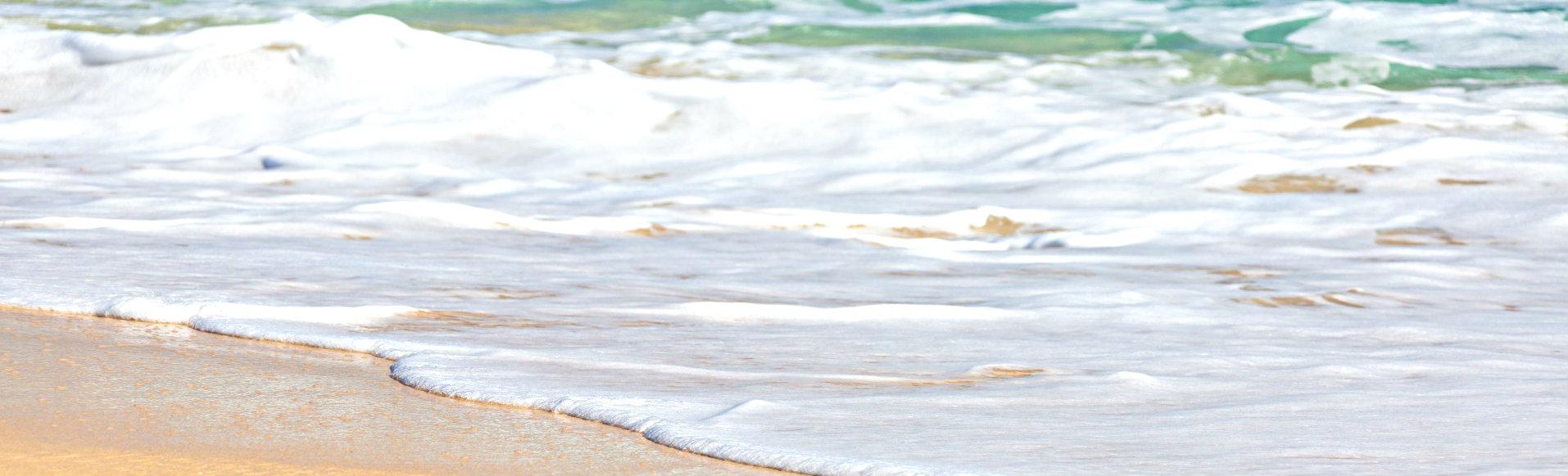 Foamy waves on beach shore